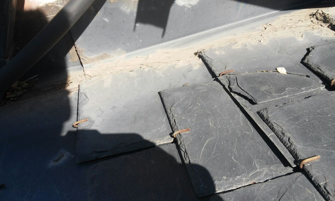 limas deterioradas en el tejados de pizarra Madrid